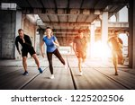 group of athletes exercises | Shutterstock . vector #1225202506