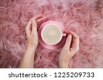 female hands and coffee cup on...   Shutterstock . vector #1225209733