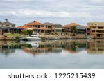 nice houses of australia right... | Shutterstock . vector #1225215439