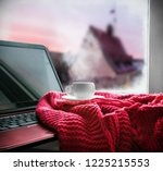 cup with a hot drink and laptop ... | Shutterstock . vector #1225215553