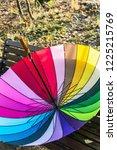 outdoor colored umbrella lying... | Shutterstock . vector #1225215769