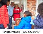 grandparents greeting mother... | Shutterstock . vector #1225221040