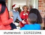 grandparents greeting mother... | Shutterstock . vector #1225221046