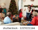 multi generation family playing ... | Shutterstock . vector #1225221166