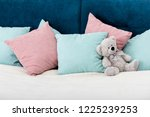 teddy bear laying on the bed... | Shutterstock . vector #1225239253