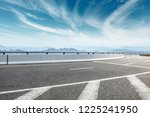 asphalt road and mountains with ... | Shutterstock . vector #1225241950