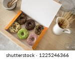 from above shot of open box... | Shutterstock . vector #1225246366