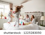 excited children jumping on... | Shutterstock . vector #1225283050
