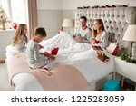 children opening gifts from... | Shutterstock . vector #1225283059