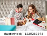couple in bed at home with pet... | Shutterstock . vector #1225283893