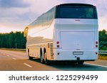 white tourist bus in the... | Shutterstock . vector #1225299499