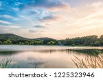 shore of the magnificent lake...   Shutterstock . vector #1225323946