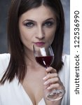 woman drinking wine | Shutterstock . vector #122536990