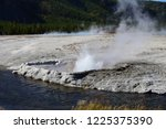 cliff geyser at the black sand... | Shutterstock . vector #1225375390