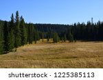 people hike the lone start... | Shutterstock . vector #1225385113