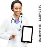 Smiling doctor holding a digital tablet isolated on white background - stock photo
