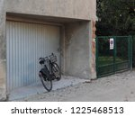 bicycle parked in front of a... | Shutterstock . vector #1225468513