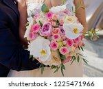 bridal bouquet in hand. | Shutterstock . vector #1225471966