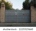 large gate with a driveway... | Shutterstock . vector #1225525660