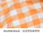 orange and white checkered... | Shutterstock . vector #1225526593