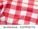 red and white checkered creased ... | Shutterstock . vector #1225526776