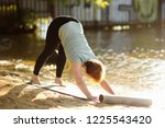 mature woman practicing yoga... | Shutterstock . vector #1225543420