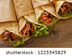 Small photo of Mexican burrito with chicken, vegetables, pepper and beans. Burrithos takos food