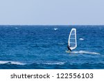 windsurfing on a sunny day | Shutterstock . vector #122556103