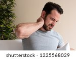 one man suffering neck pain... | Shutterstock . vector #1225568029