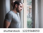man suffering and feeling alone ... | Shutterstock . vector #1225568053