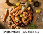 homemade cajun seafood boil... | Shutterstock . vector #1225586419