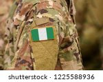 nigeria flag on soldiers arm.... | Shutterstock . vector #1225588936