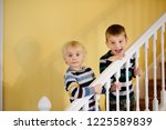 two cute little boys in striped ... | Shutterstock . vector #1225589839