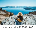 Girl sitting near Crater Lake overlook