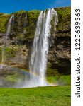 beautiful waterfall of... | Shutterstock . vector #1225639363