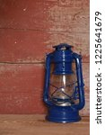 a blue camping lantern on red... | Shutterstock . vector #1225641679