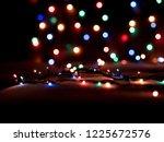 christmas lights blurred... | Shutterstock . vector #1225672576