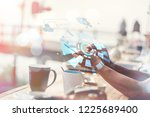 man using his mobile phone... | Shutterstock . vector #1225689400