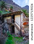 ruins of an old house in masca... | Shutterstock . vector #1225715026