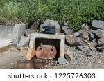 unsightly drainage ditch placed ... | Shutterstock . vector #1225726303