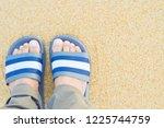 man's feet wear gray and white...   Shutterstock . vector #1225744759