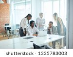 indian boss sharing with his... | Shutterstock . vector #1225783003