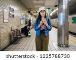 young travel woman using...   Shutterstock . vector #1225788730