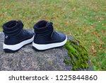 two new black child sneaker... | Shutterstock . vector #1225844860