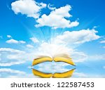 open book blue sky and... | Shutterstock . vector #122587453