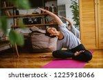 Woman Doing Yoga Exercises...
