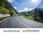 the highway is in green forest.   Shutterstock . vector #1225935850