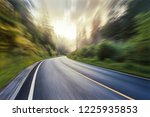 the highway is in green forest.   Shutterstock . vector #1225935853