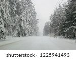 snowfall in the countryside... | Shutterstock . vector #1225941493