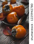 ripe orange persimmon fruit and ... | Shutterstock . vector #1225942780